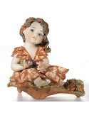 Sibania Autumn figure porcelain baby on base with grape four seasons collection.